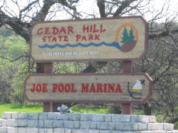 the entrance sign for Cedar Hill State Park